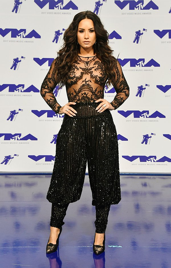 9f3ab689b16 Demi Lovato slayed the 2017 VMA red carpet pairing a revealing black lace  top with black