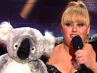 Rebel Wilson And Her Koala, Chlamydia, Scope Out The CrowdAfter Rebel Wilson peeks in Quvenzhane Wallis' purse, our 2013 Movie Awards host introduces presenter Peter Dinklage.