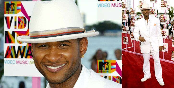Usher And His Kids On The Red Carpet. Red Carpet at his feet.