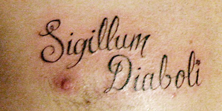 "Bam's wedding tattoo, which reads ""Sigillum Diaboli"" in Latin,"