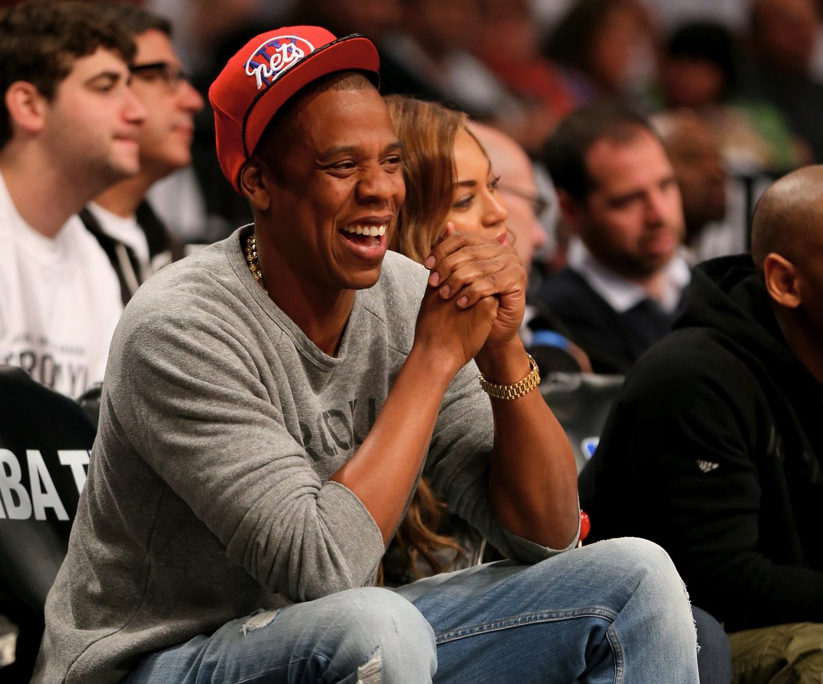 Jay Z laughs as his team crushes in the Toronto Raptors v Brooklyn Nets game