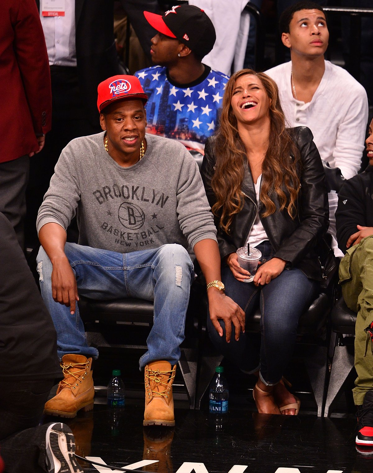 Jay Z remains focused while Beyonce laughs it up