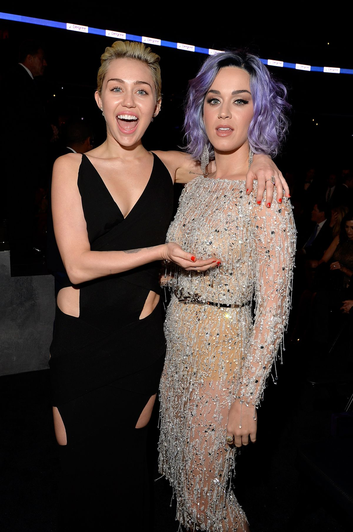 Miley Cyrus Cups Katy Perry's Boob At The 57th Annual GRAMMY Awards