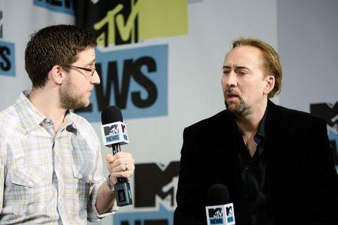 SAN DIEGO - JULY 23: MTV News host Josh Horowitz (L) and actor Nicolas Cage speak at the MySpace & MTV Tower During Comic-Con 2010 - Day 2 on July 23, 2010 in San Diego, California.  (Photo by Jerod Harris/Getty Images for MySpace)
