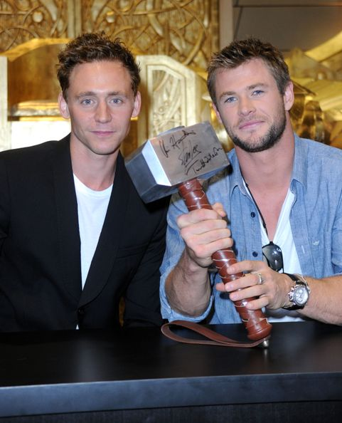 SAN DIEGO - JULY 24:  Actors Tom Hiddleston and Chris Hemsworth sign autographs during Comic-Con 2010 on July 24, 2010 in San Diego, California.  (Photo by Frazer Harrison/Getty Images)