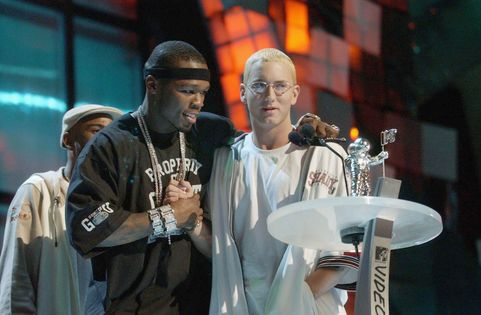 NEW YORK - AUGUST 28:  50 Cent (L) congratulates Eminem for receiving the award for Best Video From A Film during the 2003 MTV Video Music Awards at Radio City Music Hall on August 28, 2003 in New York City.  (Photo by Frank Micelotta/Getty Images)