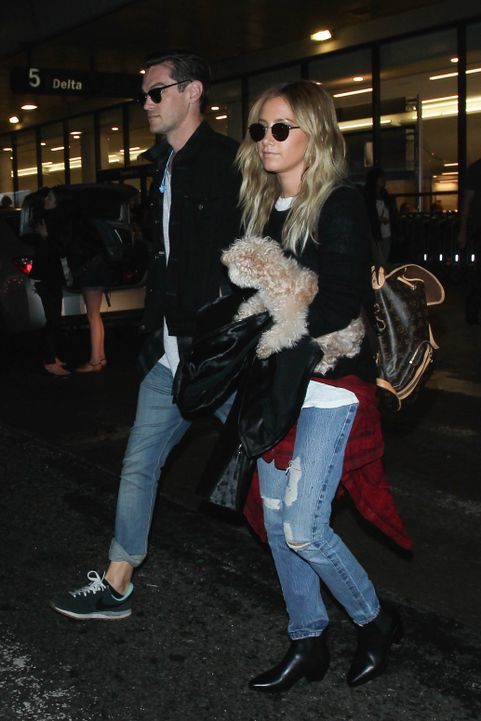LOS ANGELES, CA - JUNE 16: Ashley Tisdale and Christopher French are seen at LAX. on June 16, 2015 in Los Angeles, California.  (Photo by GVK/Bauer-Griffin/GC Images)