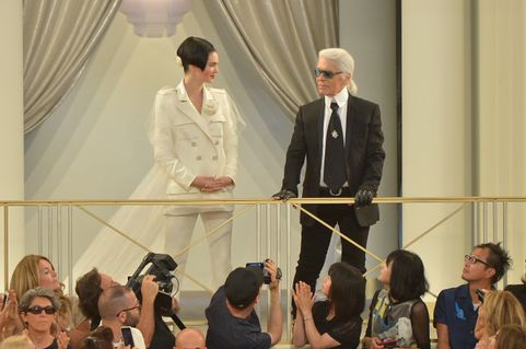PARIS, FRANCE - JULY 07:  Designer Karl Lagerfeld and model Kendall Jenner at the end of the Chanel show as part of Paris Fashion Week Haute Couture Fall/Winter 2015/2016 on July 7, 2015 in Paris, France.  (Photo by Dominique Charriau/WireImage)