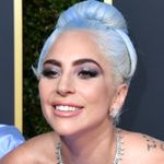Lady Gaga's Golden Globes Dress Was So Long, It Took Two People To Carry It