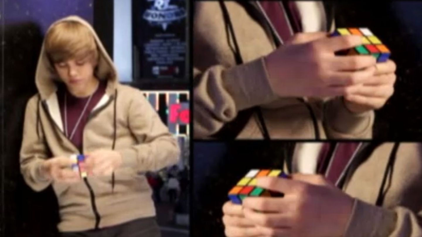 Watch A Swoopy Haired Baby Justin Bieber Solve A Rubiks Cube In