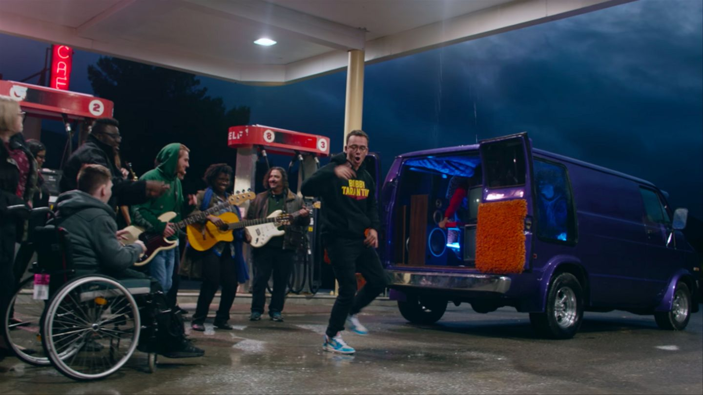 Logic And 21 Collaborators Turn A Gas Station Into A Stage In 'Do What You Love' Video