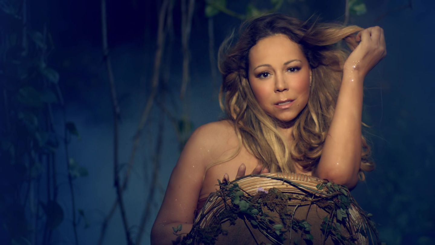 A Glittery, Naked Mariah Carey Transforms Into A Gorgeous