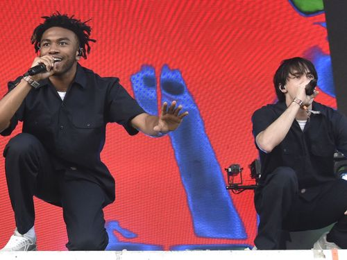 BROCKHAMPTON Use Dark Churches And Rocking Boats To Show Their Sadness In 'No Halo'
