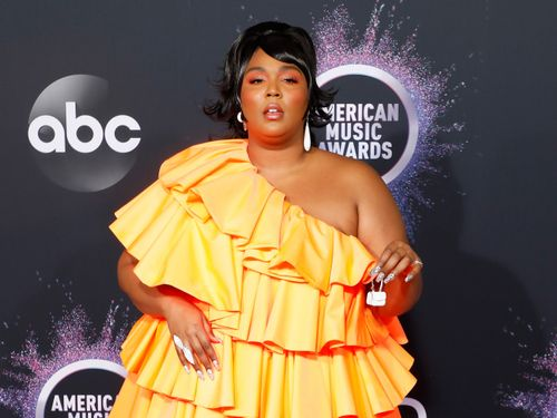 Lizzo Finally Reveals What's In That Tiny Purse Of Hers