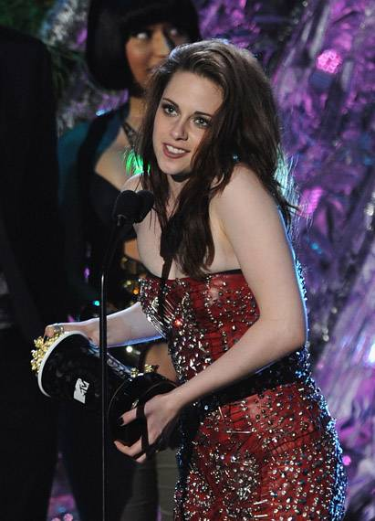 Kristen Stewart photographed on stage while accepting the Best Female Performance award for her role in 'The Twilight Saga: Eclipse' at the 2011 MTV Movie Awards in Los Angeles.
