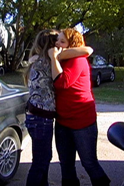 Cateylnn hugs her mom after their counseling session.