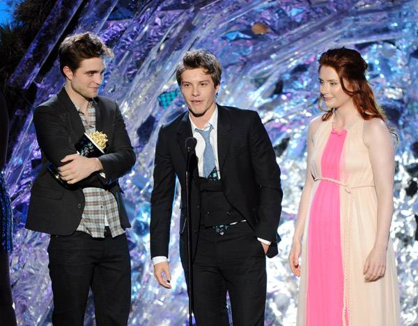 Robert Pattinson, Xavier Samuel and Bryce Dallas Howard photographed on stage while accepting the Best Fight award for 'The Twilight Saga: Eclipse' at the 2011 MTV Movie Awards in Los Angeles.