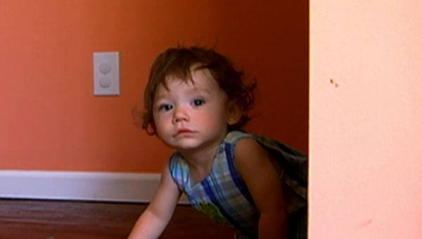 Baby Jace crawls around the house.