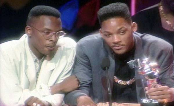 """1989 - DJ Jazzy Jeff and the Fresh Prince stare lustfully into the audience while accepting their Best Rap Video Moonman for """"Parents Just Don't Understand."""""""
