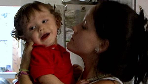 Jenelle gives baby Jace a kiss.