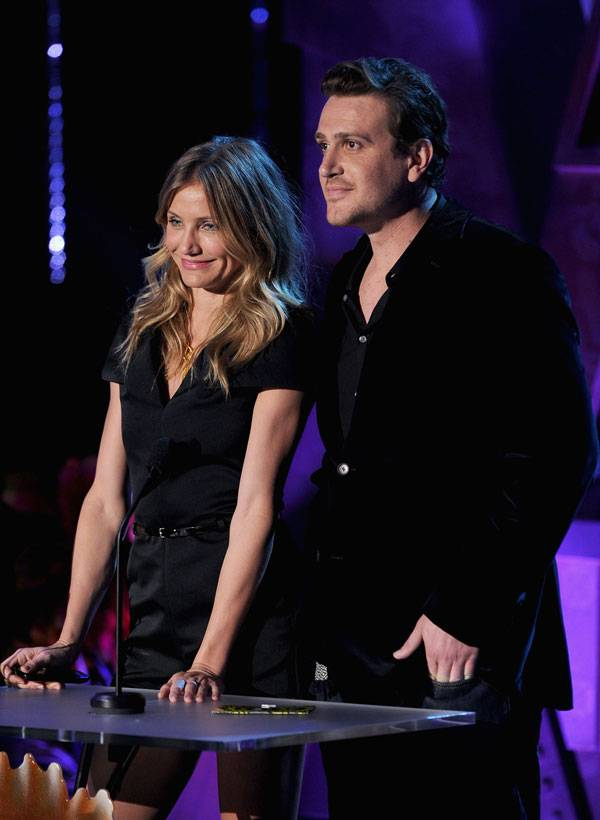 The cast of 'Bad Teacher,' including Cameron Diaz and Jason Segel, photographed on stage while presenting the Best Line From A Movie award at the 2011 MTV Movie Awards.