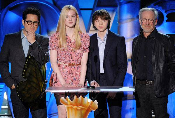 J.J. Abrams, Elle Fanning, Joel Courtney and Steven Spielberg photographed on stage while presenting a preview from the movie 'Super 8' at the 2011 MTV Movie Awards.