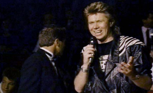1987 - As MTV Australia VJ Richard Wilkins takes his turn at the mic, it becomes clear that he's all business in the front, a party in the back and a zebra on the shoulders.