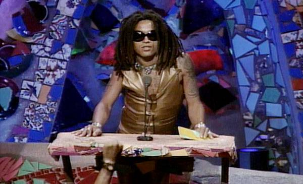 1991 - With nothing more than a glance, Lenny Kravitz reminds us to love and rub a dub, as he presents a Moonman at the '91 VMAs.