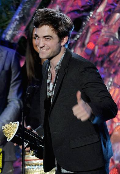 Robert Pattinson photographed on stage while accepting the Best Male Performance award for his role in 'The Twilight Saga: Eclipse' at the 2011 MTV Movie Awards in Los Angeles.
