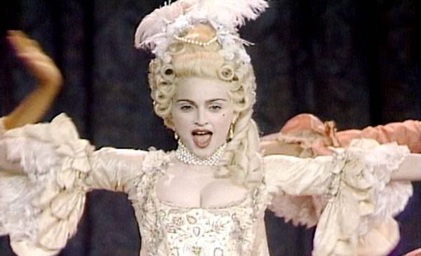 """1990 - The ever-shocking Madonna channels Marie Antoinette in her highly stylized performance of """"Vogue."""""""