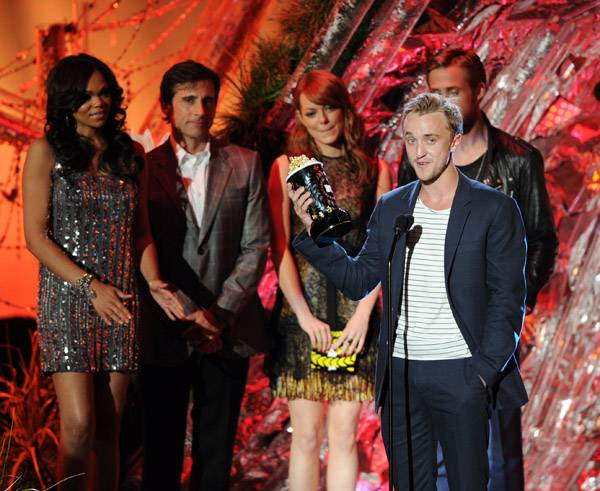 Tom Felton photographed on stage while accepting the Best Villain award for his role in 'Harry Potter and the Deathly Hollows: Part 1' at the 2011 MTV Movie Awards in Los Angeles.
