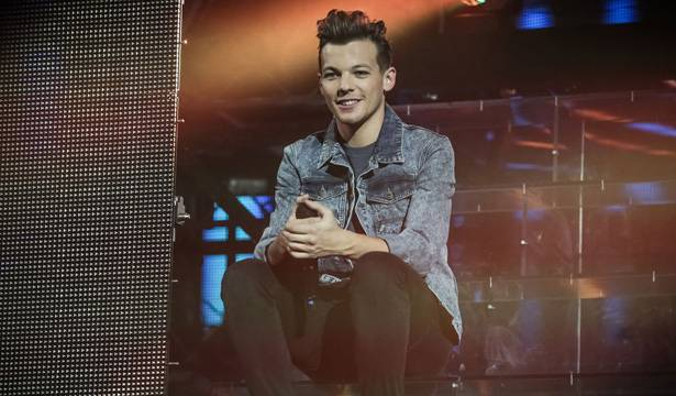 One Direction - Louis chills out on stage.