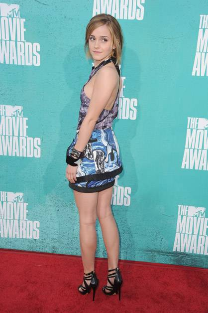 Emma Watson poses on the red carpet at the 2012 MTV Movie Awards.
