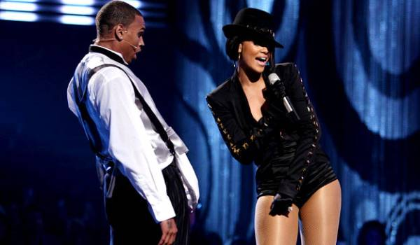 2007 - Even Chris Brown is blown away by Rhianna's performance of 'Umbrella' when the two share a stage at the VMAs.
