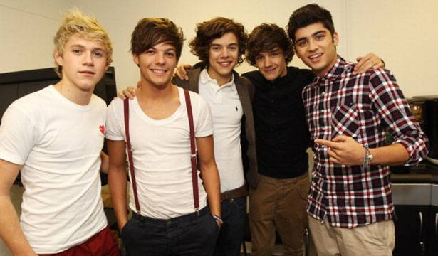 Niall Horan, Louis Tomlinson, Harry Styles, Liam Payne, and Zayn Malik of One Direction pose for photographs while visiting Glasgow, Manchester and London on September 11, 2011.