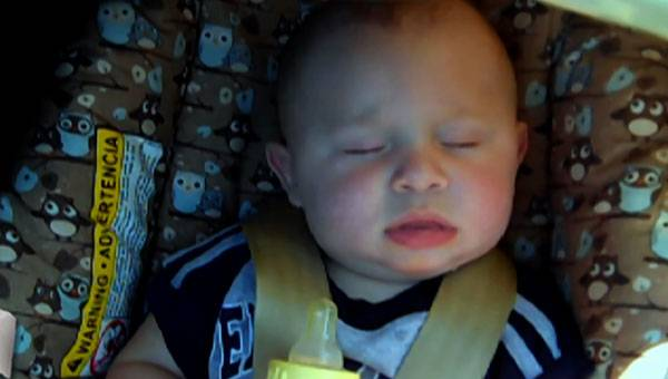 Baby Isaac sleeps.