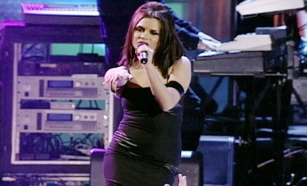 """1997 - Posh Spice, aka Victoria Beckham, croons along with Scary, Sporty and the girls o the song, """"Say You'll Be There."""""""