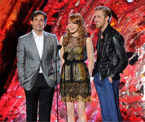 The cast of 'Crazy, Stupid, Love,' including Steve Carell, Emma Stone and Ryan Gosling photographed on stage while presenting the Best Villain award at the 2011 MTV Movie Awards.