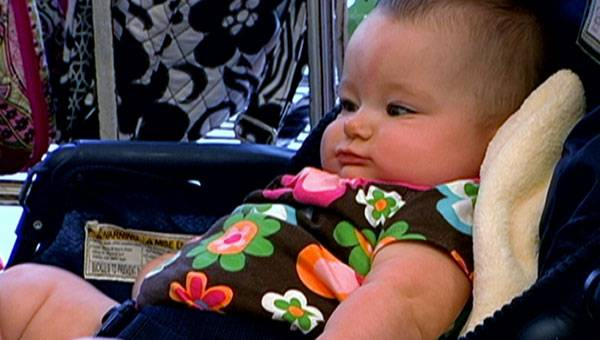 Baby Ali goes shopping with mom Leah.