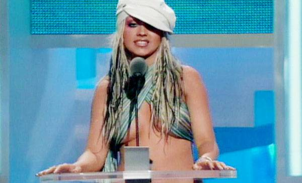 2002 - Presenter Christina Aguilera discovers that her scarf can double as (most of) a top.