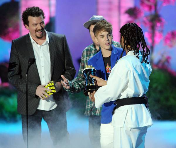 Justin Bieber photographed on stage while accepting the Best Jaw Dropping Moment award for 'Never Say Never' at the 2011 MTV Movie Awards in Los Angeles.