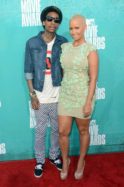 Wiz Khalifa and Amber Rose pose on the red carpet at the 2012 MTV Movie Awards.