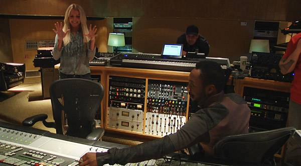 """will.i.am plays the finished version of """"Big Fat Bass"""" for Britney."""