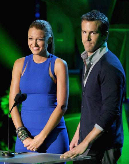 The cast of 'Green Lantern,' including Blake Lively and Ryan Reynolds, photographed on stage while presenting the Best Kiss award at the 2011 MTV Movie Awards.
