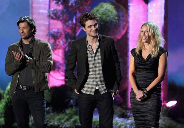 Patrick Dempsey, Robert Pattinson and Chelsea Handler photographed on stage while presenting the MTV Generation Award at the 2011 MTV Movie Awards.