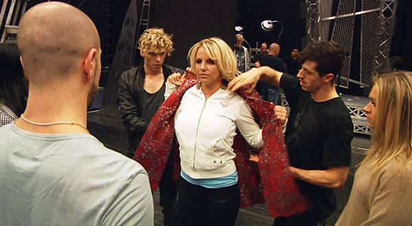 In advance of her first tour in over a year, Britney rehearses a costume change with her backup dancers.