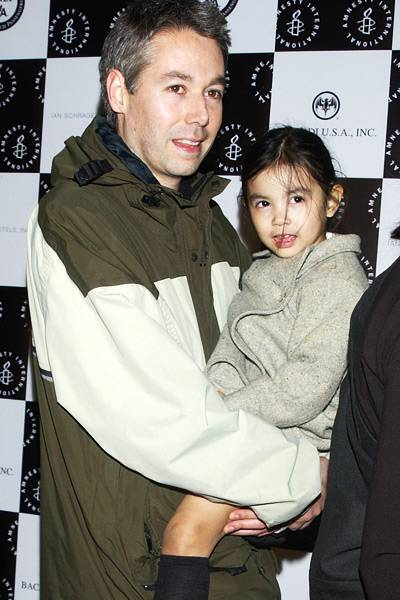 Adam Yauch with his daughter at Amnesty International's 5th Annual Media Spotlight Awards in New York in 2002
