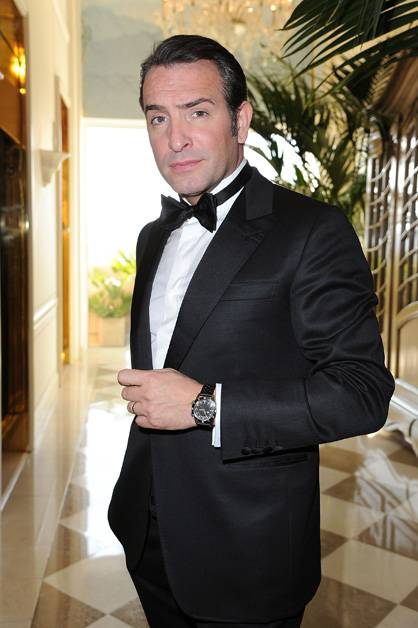 Jean Dujardin strikes a pose before attending the 84th Academy Awards.