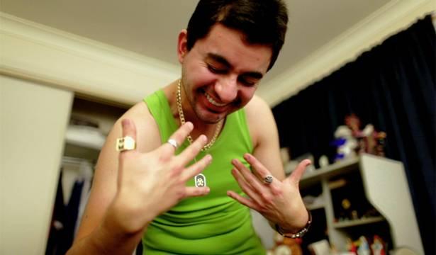 Carlos models his bling for Jules.