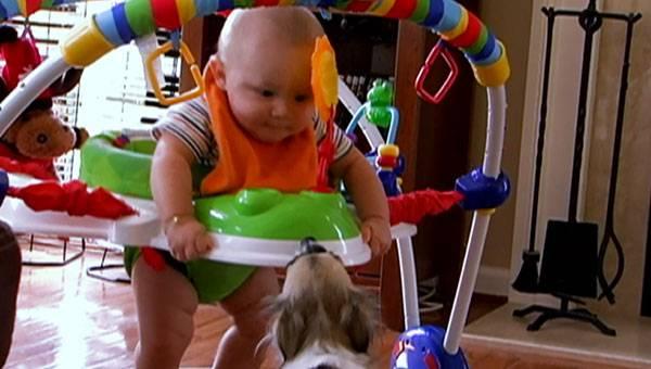 Baby Isaac plays with his grandma.